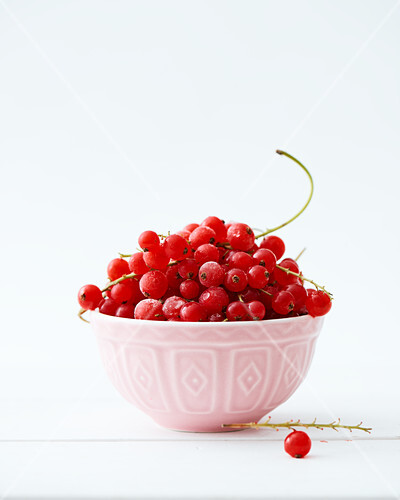 Frozen cranberries in a small ceramic bowl