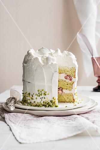 Cream cake with pistachios and raspberries