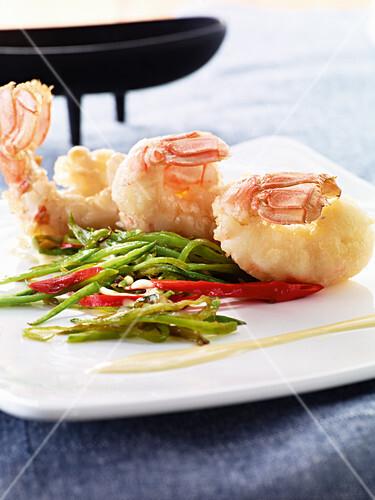 Prawn tempura on a mange tout salad
