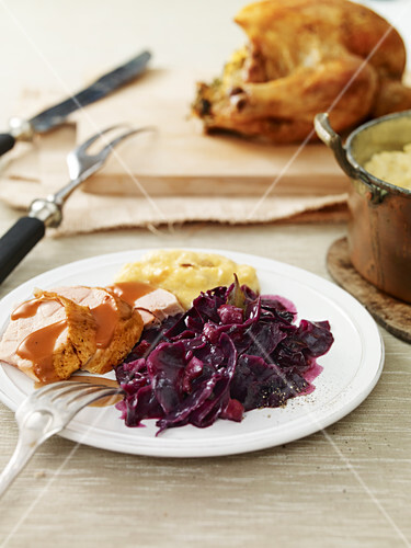 Crispy duck with red cabbage and apple and olives
