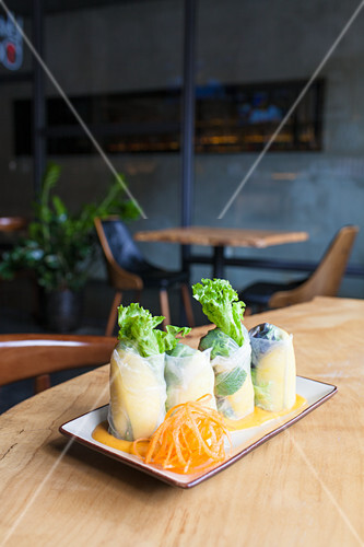 Vegan summer rolls-mango, avocado, lettuce and mint, with mango dipping sauce