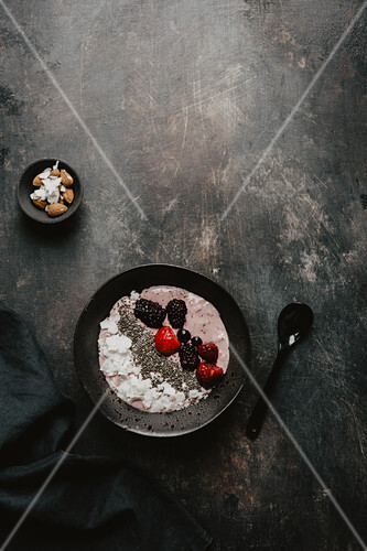 A smoothie bowl with berries and chia seeds