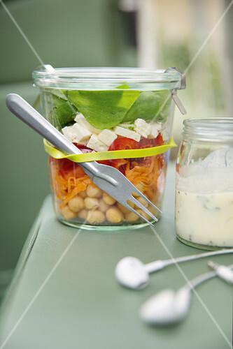 Rainbow salad with feta cheese in a jar