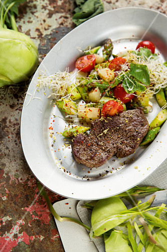 Beef fillet with vegetables and sprouts