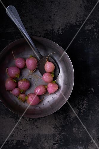 Glazed radishes in bowl