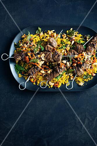 Beef kebabs with spicy quinoa nut pilaf