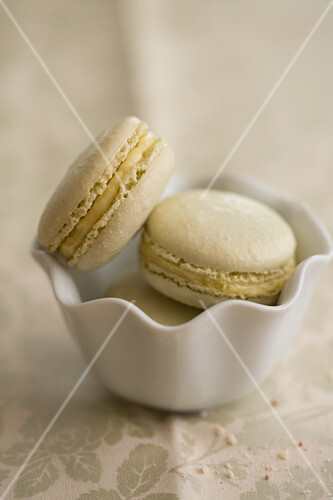 Green macarons in a porcelain bowl