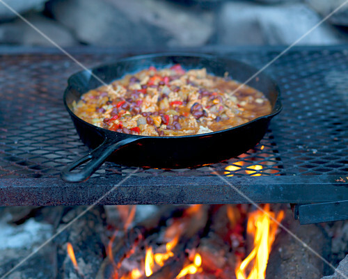 Chili in a pan on a campfire