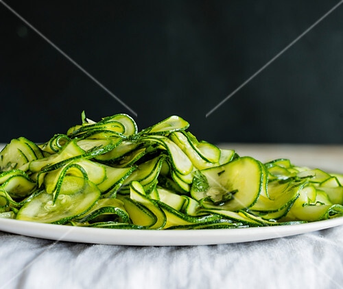 Thinly sliced zucchini on a plate