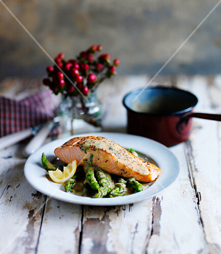 Salmon with herb mustard sauce, asparagus and lemon