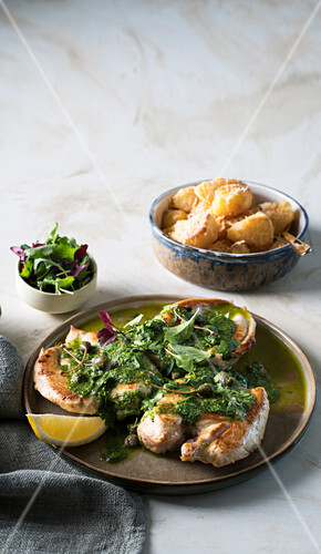 Seared chicken with herb salsa and parmesan roast potatoes