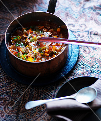 Hungarian goulash soup in a copper pot