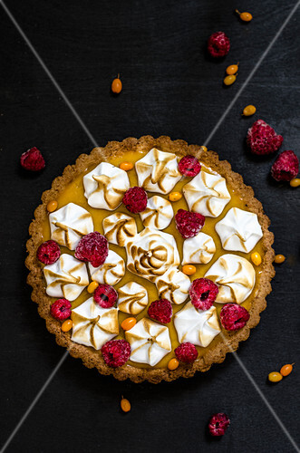 Lemon tart with meringue and raspberries