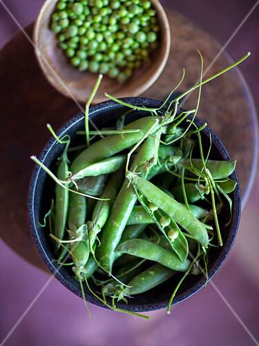 Fresh pea pods and peas