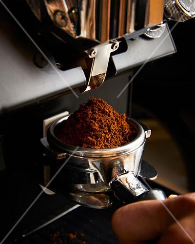 Espresso being ground into a basket