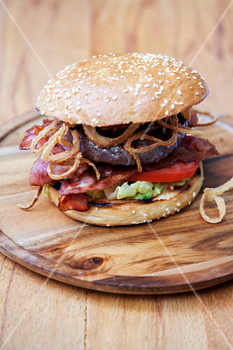 Grilled American range burger with guacamole and BBQ sauce
