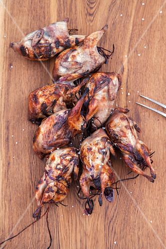 Grilled quails in bourbon berry brine