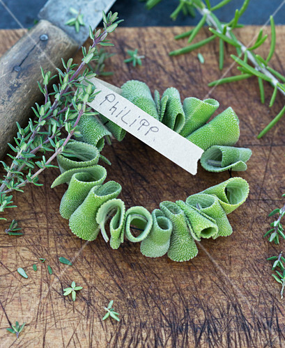 Rolled sage laves threaded on wire with name tag