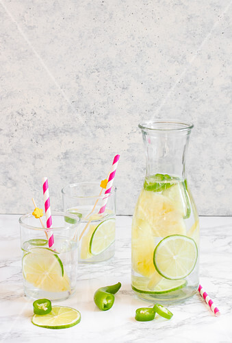 Summer lime lemonade with chilli in a karafe and glasses