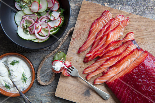 Beetroot and gin cured salmon with pickled radishes and cucumber