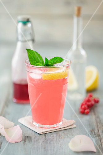 Sharbat (Persian lemonade) with redcurrant syrup, lemon and rose water