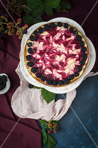 Blackberry swirled cheesecake on romantic cake stand (seen from above)