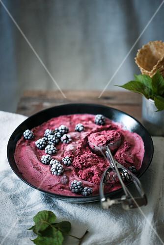 A bowl of vegan blackberry ice cream
