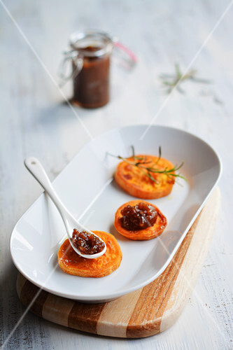 Roasted sweet potato slices with carrot and onion chutney
