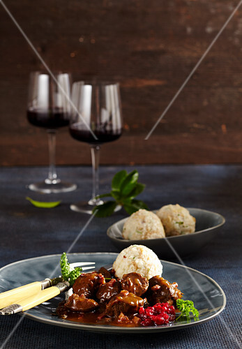 Venison ragout with a mulled wine sauce, bread dumplings and lingon berry compote