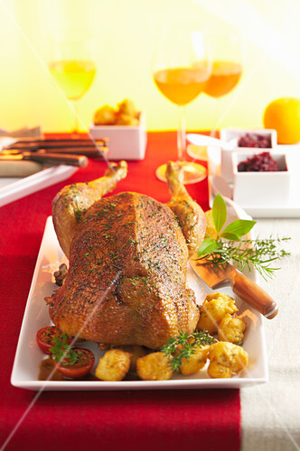 Roast goose with a chestnut and quince filling and potato-pistachio fritters