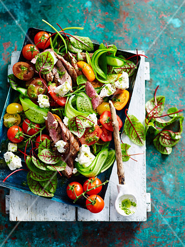 Lamb and tomato salad with swiss chard and feta