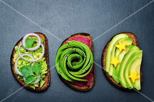 Variation of healthy rye breakfast sandwiches with avocado and toppings. toning