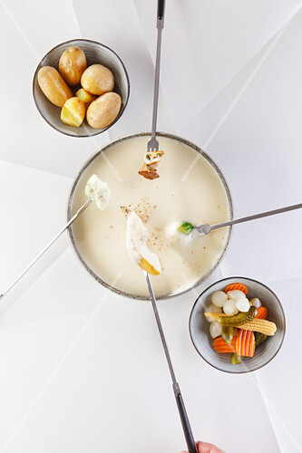 Cheese fondue with various vegetables