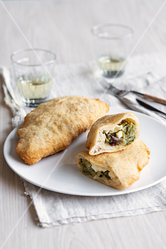 Fried pizza pockets with chicory, olives and anchovies