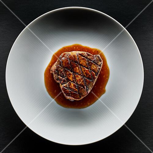 Grilled beef steak with gravy