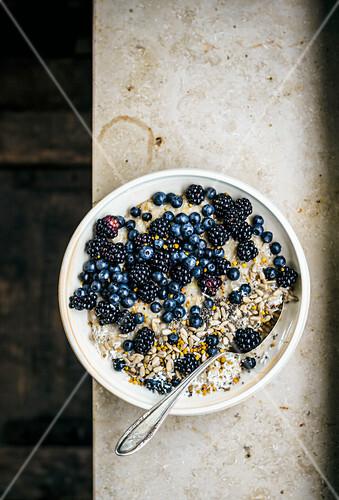 Porridge with berries, seeds, and bee pollen