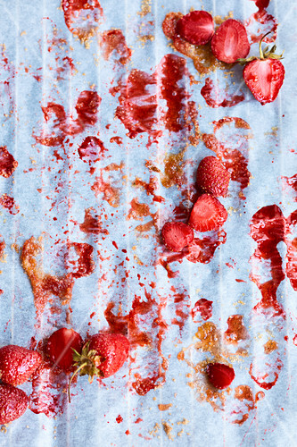 Strawberries and remains of juice on baking paper
