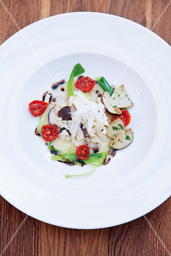 Porcini mushroom risotto with oven roasted tomatoes and brown butter vinaigrette