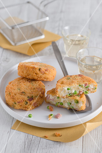 Fried bechamel pasta cakes with peas and provola