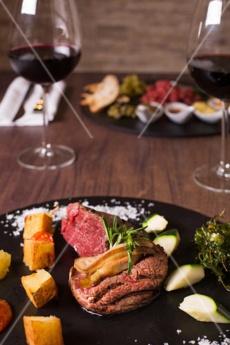 Beef fillets with goose livers, zucchini and potatoes