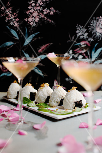 Onigiri (rice balls with salmon, Japan) served with cocktails