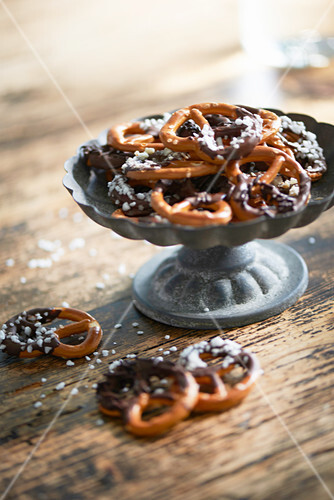 Mini pretzels with chocolate glaze and sugar nibs