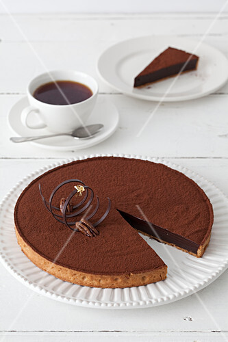 Chocolate torte with an elegant tuile served with a coffee