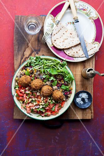 Quinoa, buddah bowl with coriander, falafel, mint, pinenuts and watercress