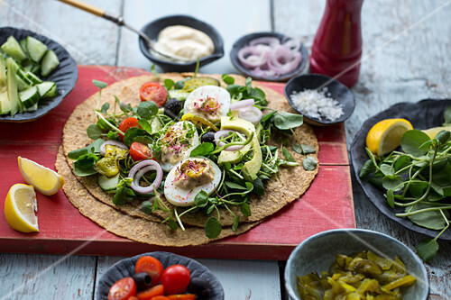 Wraps with deviled eggs, micro herbs, avocado and tomatoes