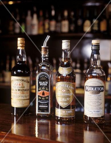 Four Irish whiskey bottles