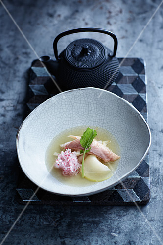 Smoked trout in its own broth with apples and radishes