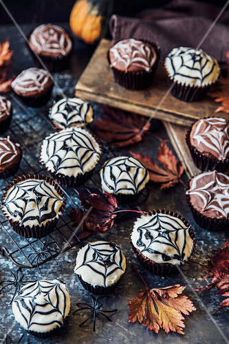 Cobweb cakes for Halloween with mini pumpkins