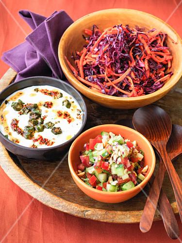 Indian salads - red cabbage and pepper Bhindi, raita okra salad, cucumber and tomato salad