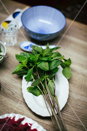A bunch of Thai basil on a plate